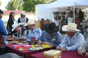 Light Hands Horsemanship Clinicians signing autographs